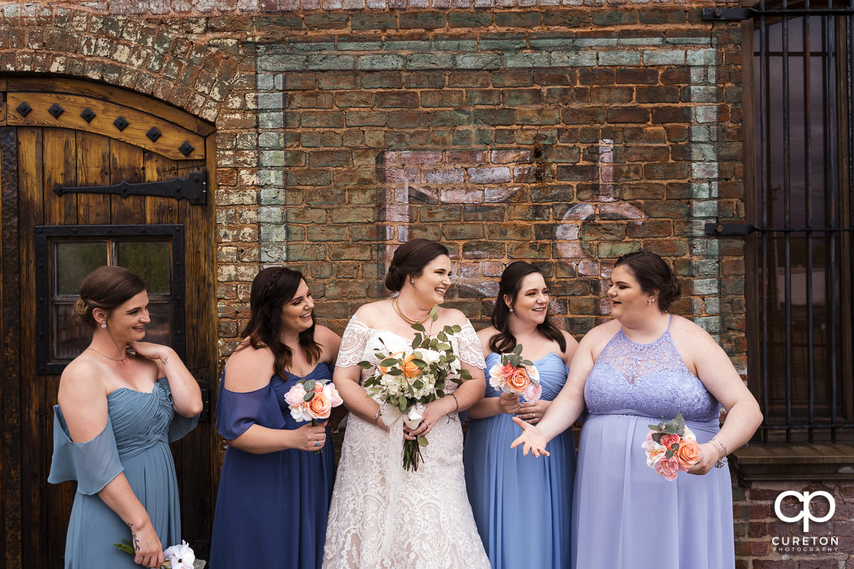 Bride having fun with her bridesmaids on the deck of The Old Cigar Warehouse.