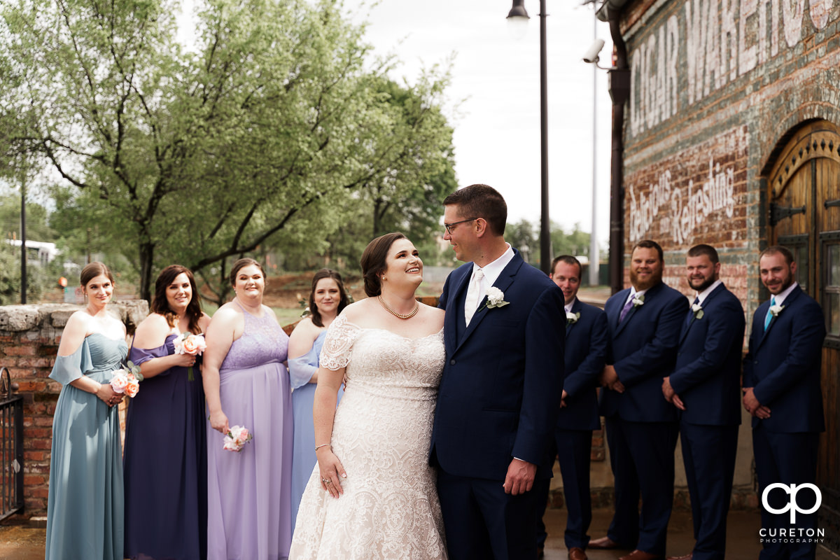 Bride and groom surrounded by her bridal party on the deck of The Old Cigar Warehouse.
