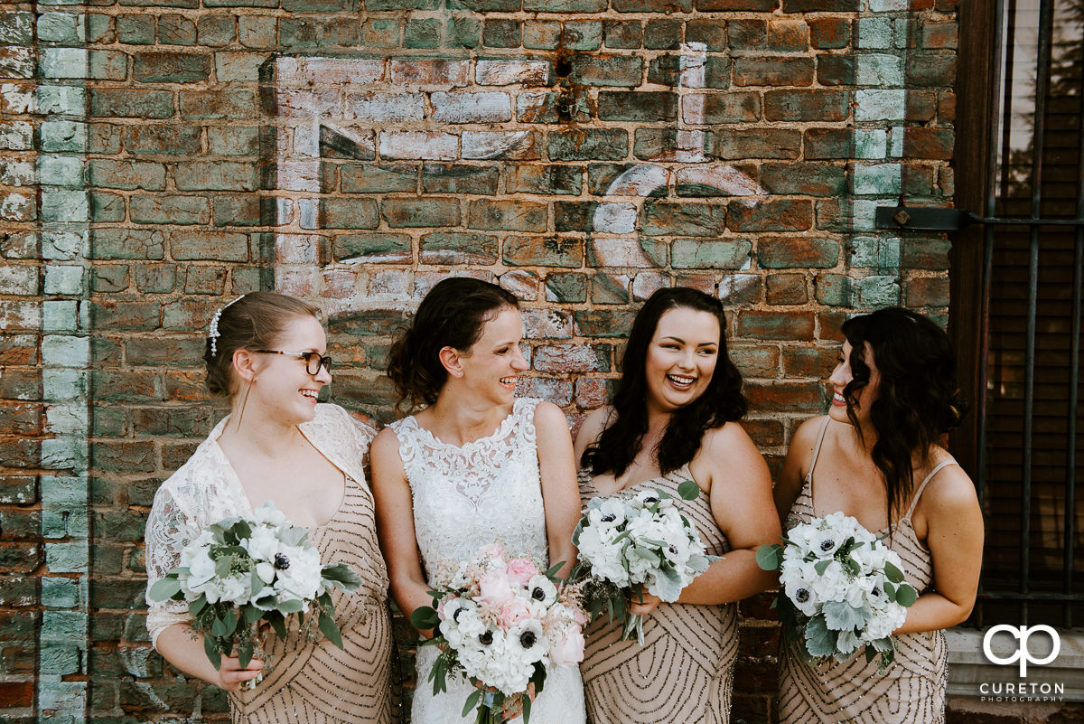 Bridesmaids laughing.