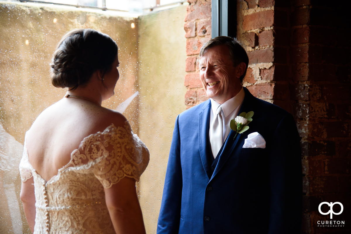 Bride seeing her dad on the wedding day for the first time.