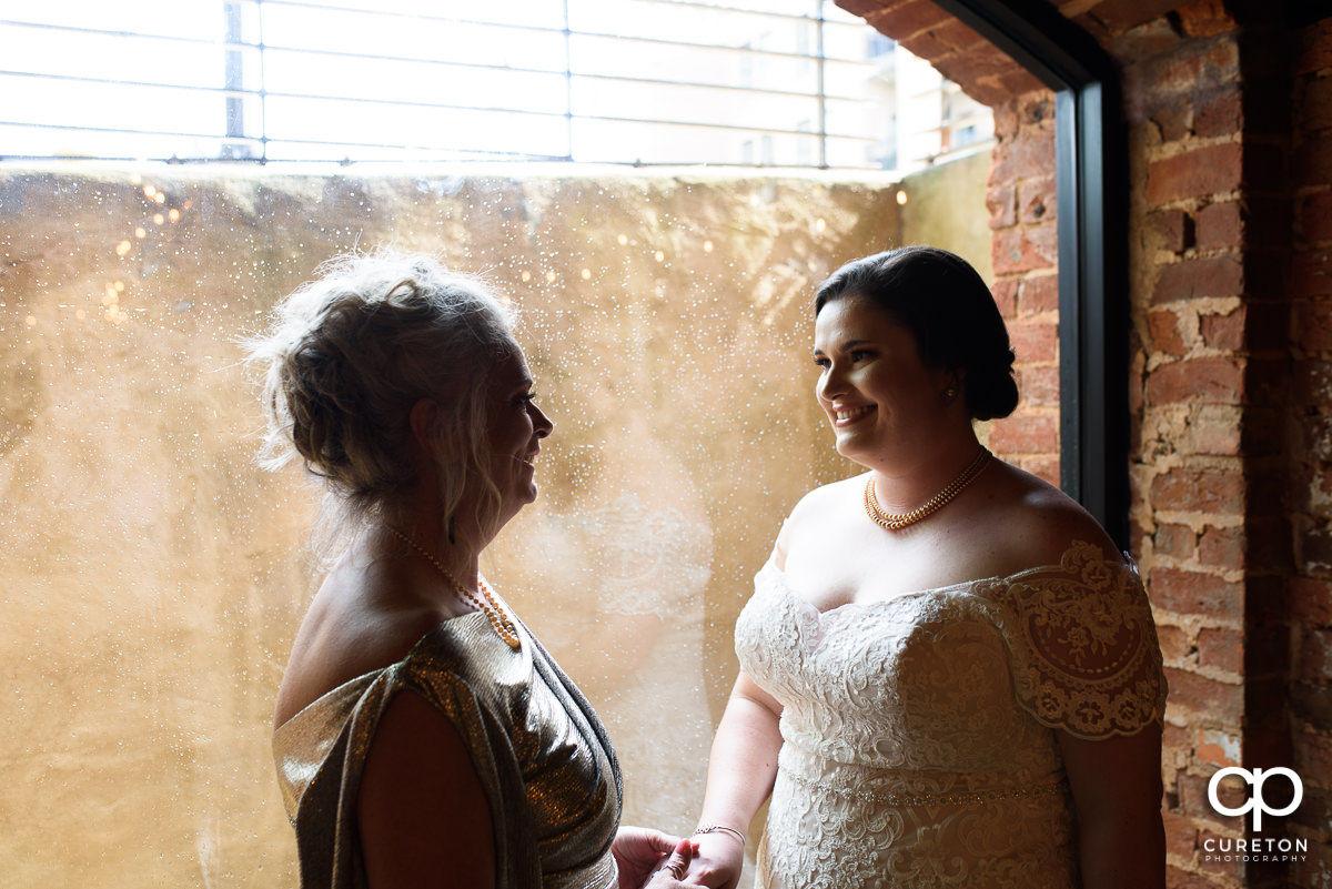 Bride having a moment with her mom.