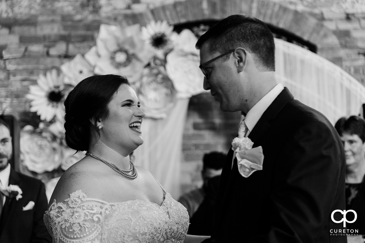 Bride laughing with her groom.