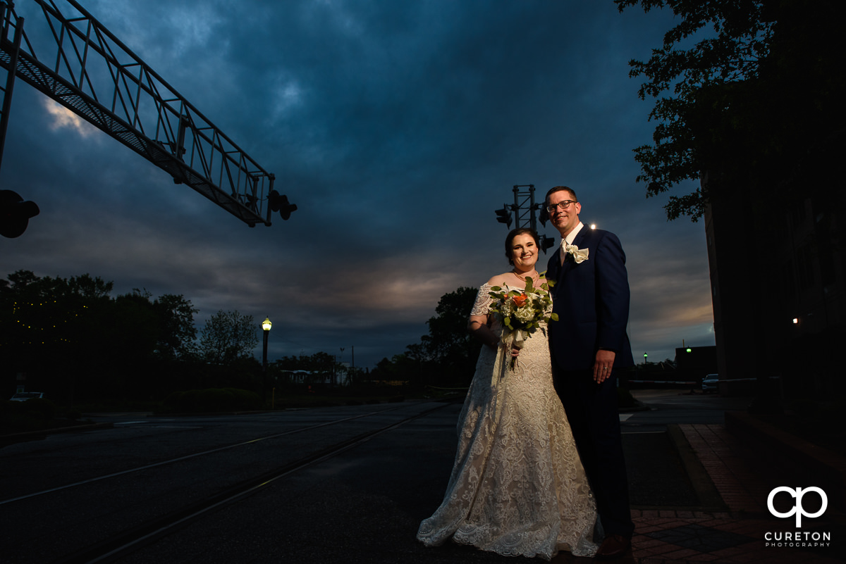 Bride and groom at sunset on Main Street in downtown Greenville,SC.