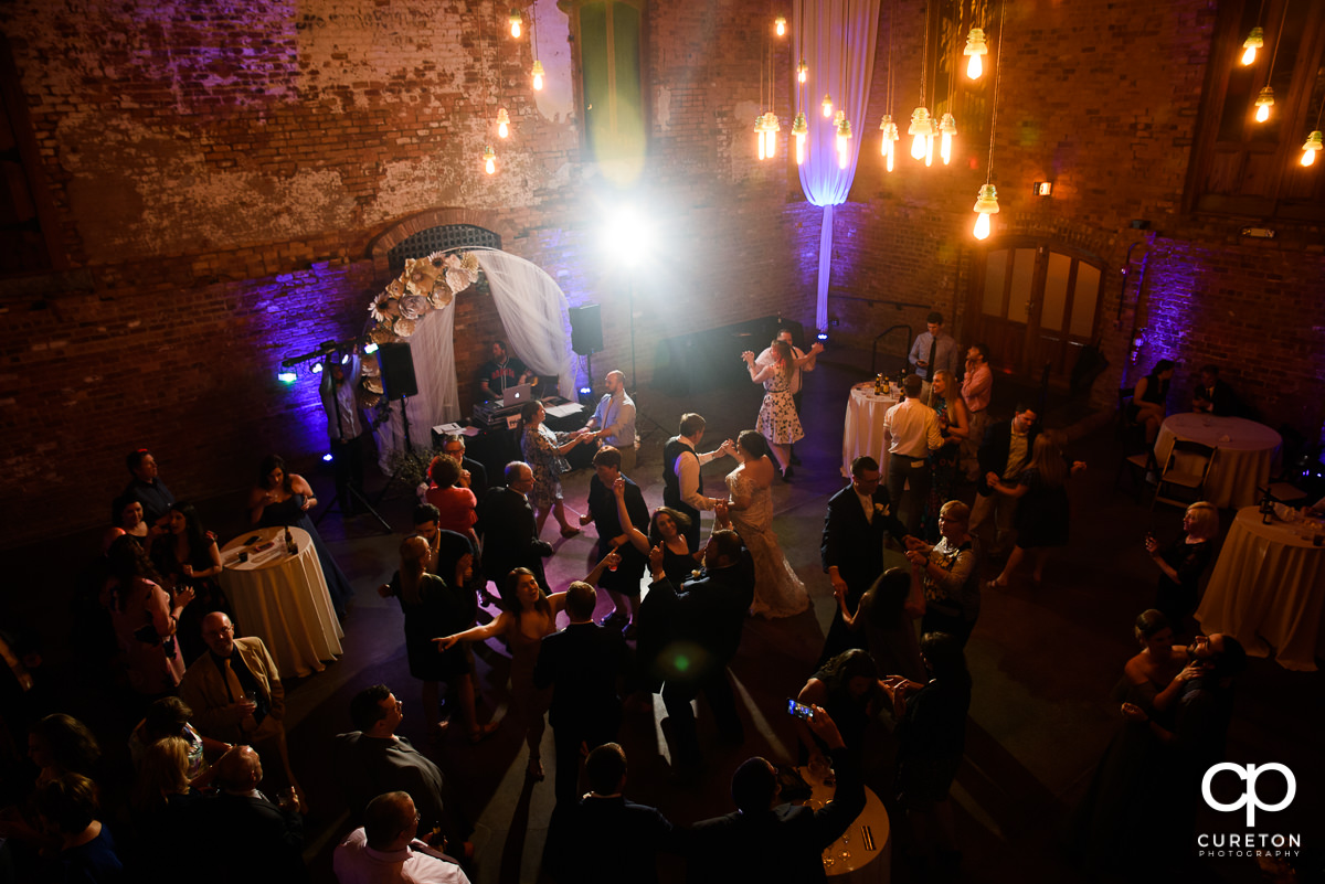 Wedding guests dancing at The Old Cigar Warehouse wedding reception.