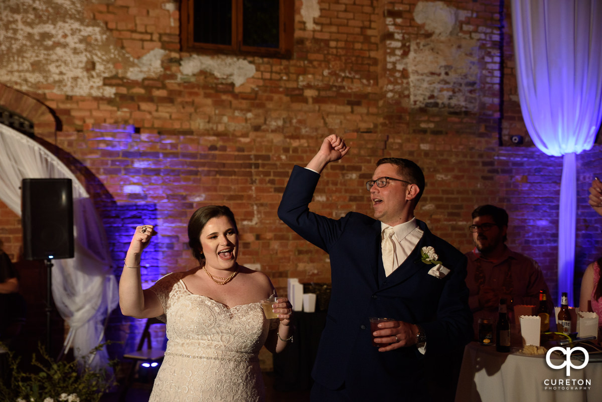 Bride and groom doing the Clemson cheer.