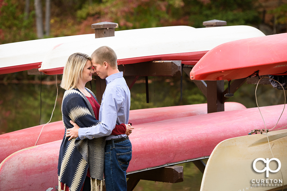 Engaged couple near the lake during the Paris mountain engagement session.