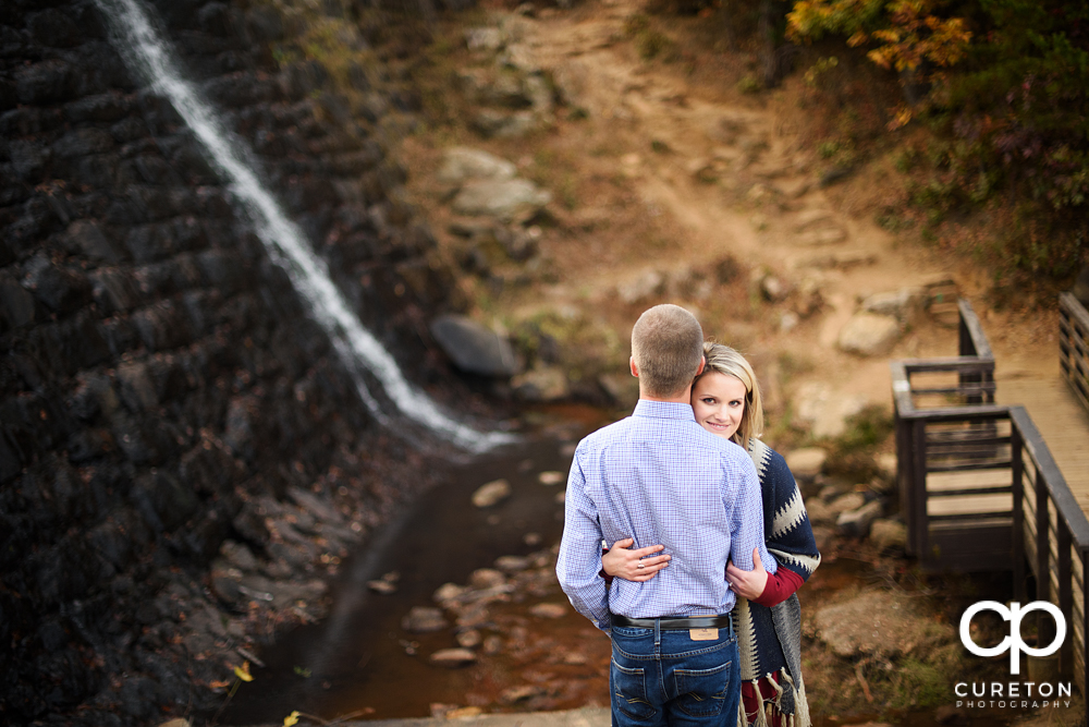 Future bride and groom in front of the falls at Paris mountain.