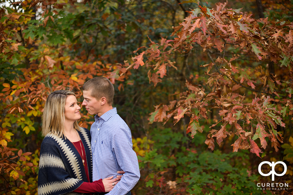 Engaged couple looking at each other.