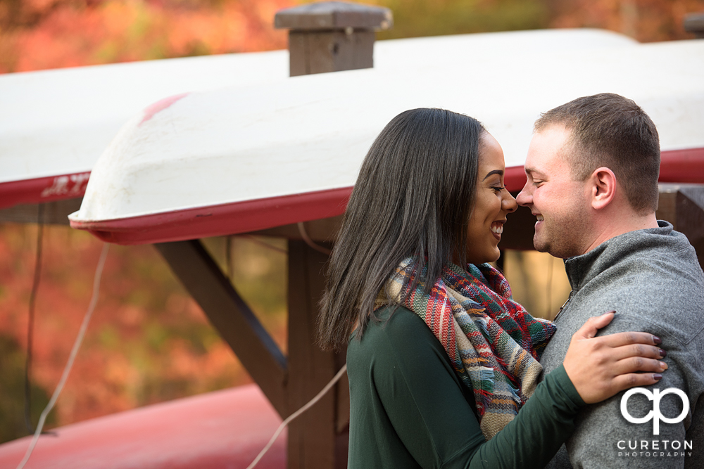 Engaged couple smiling nose to nose during their Paris Mountain State Park Engagement Session in Greenville,SC.