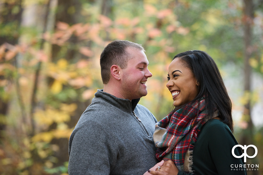 Future bride and groom during their Paris Mountain State Park Engagement Session in Greenville,SC.