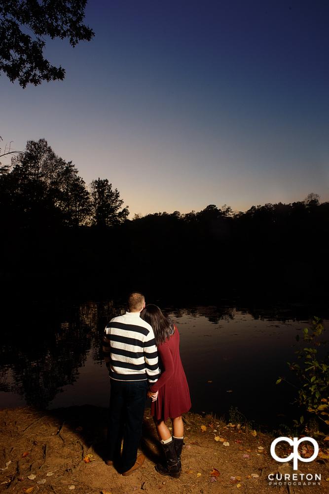 Bride and groom looking at the sunset.
