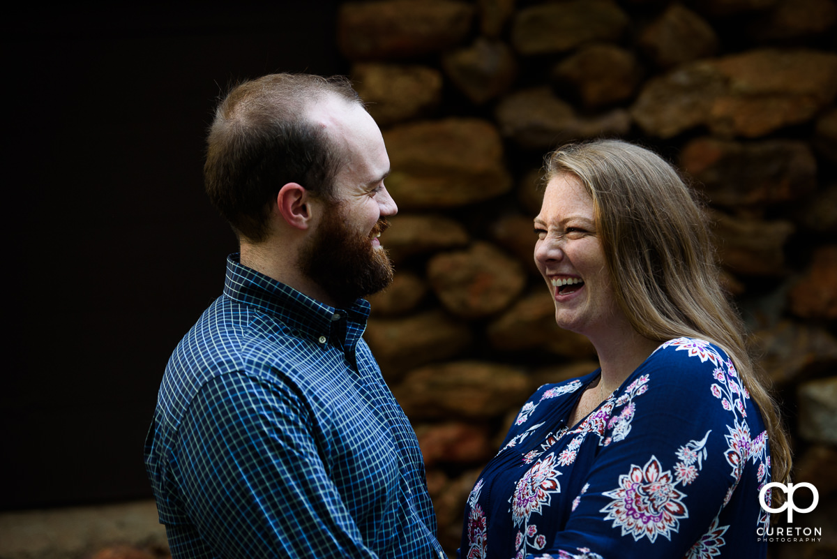 Bride and groom having fun during their engagement session.