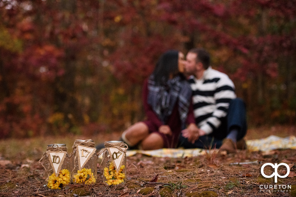 Fall save the date photo with the wedding date on Mason jars.