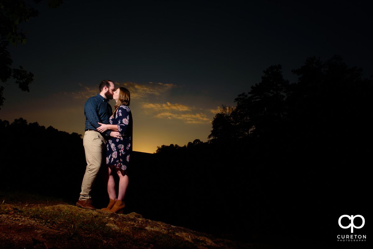 Couple kissing at sunset on Paris Mountain.