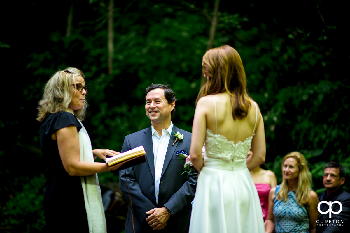 Groom smiling at the wedding officiant.