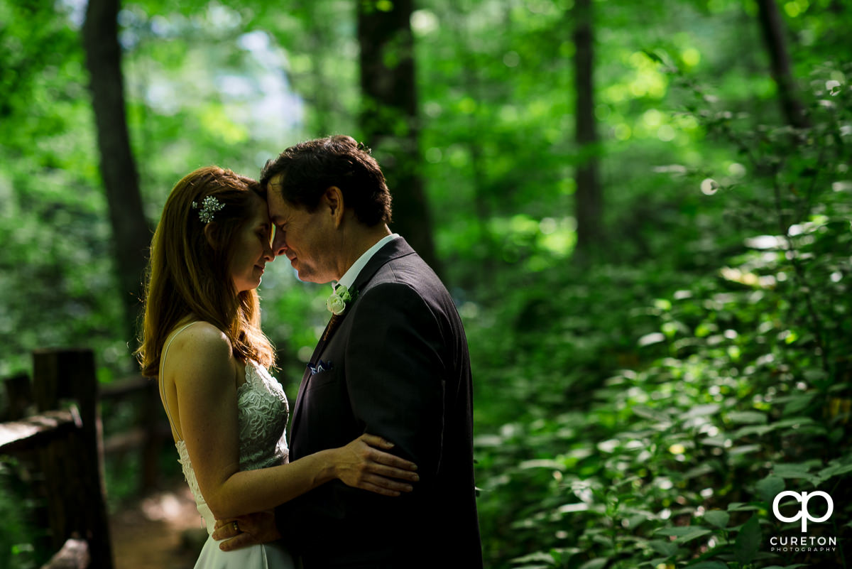 Bride and groom in the forest.