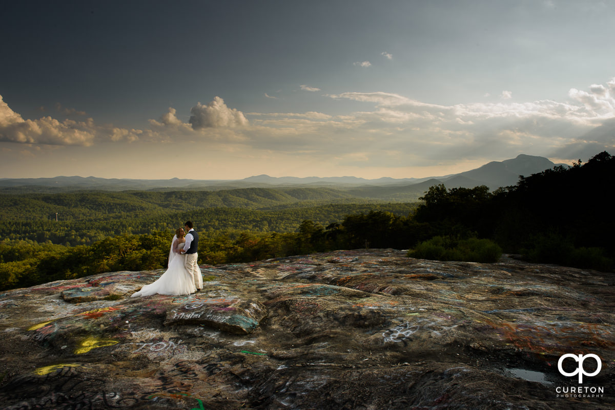 Bride and groom on Bald Rock after their wedding in the mountains.