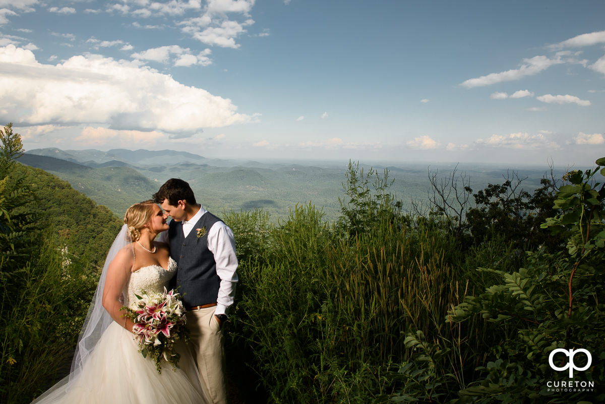 Bride and Groom standing face to face after their Pretty Place wedding.