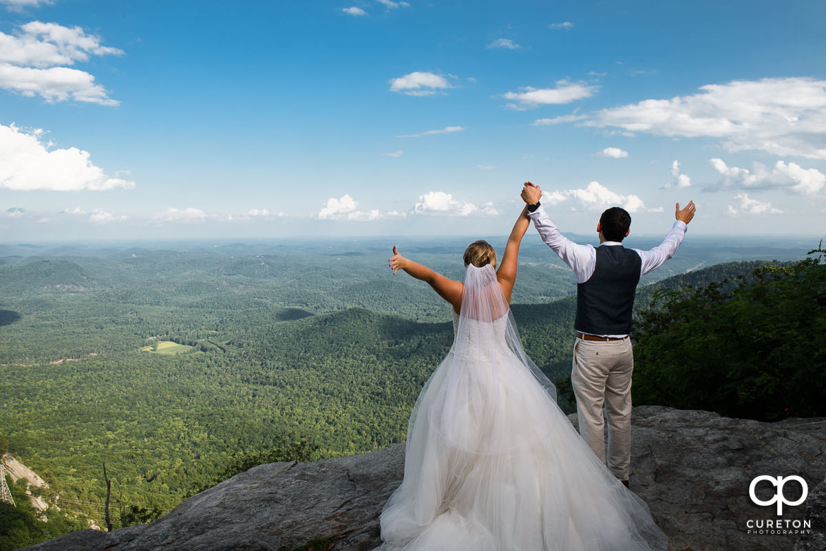 Newlywed couple on the rock at Pretty Place.