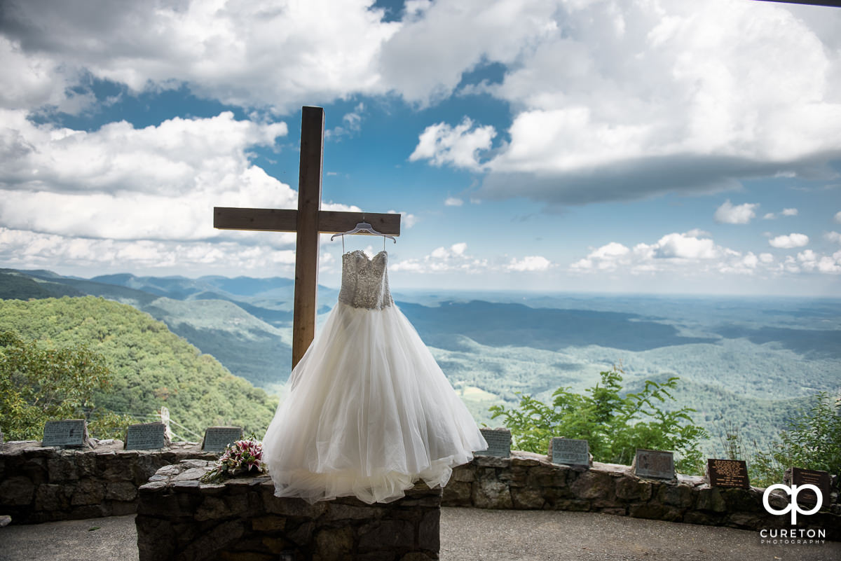 Bride's dress hanging on the cross at Pretty Place.