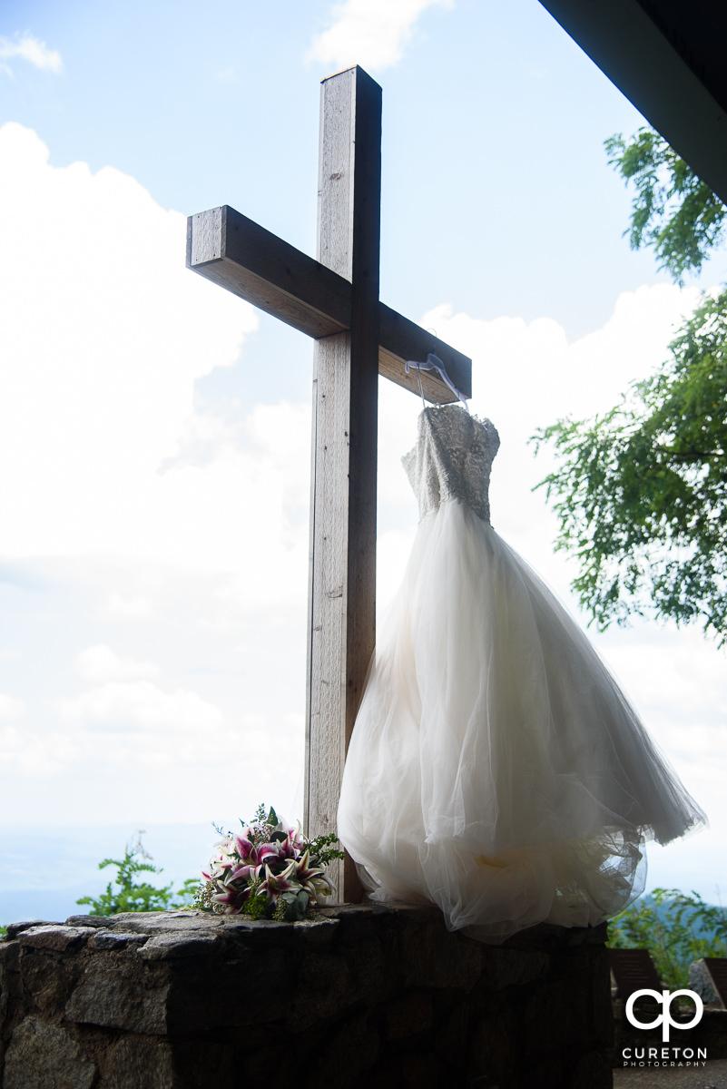 Bride's dress on the cross.