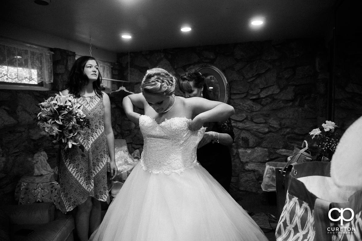 Bride getting dressed.