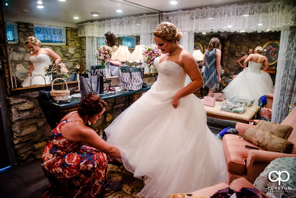 Bride putting on shoes.