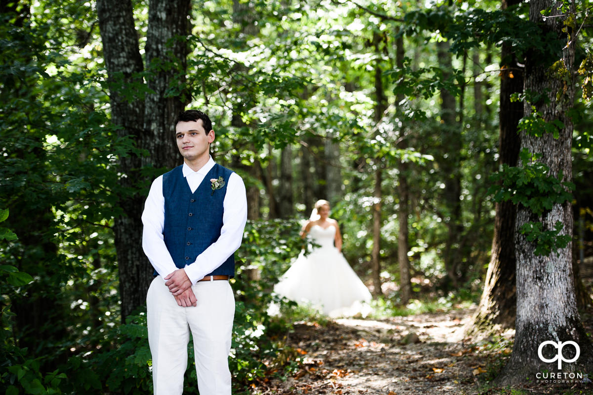 Groom awaiting his bride during the first look at Pretty Place before the wedding ceremony.