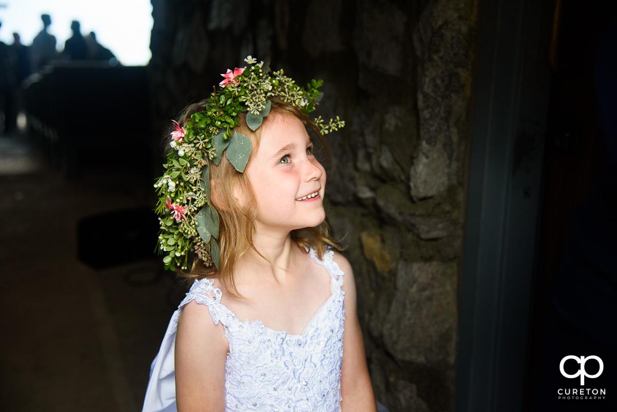 Flower girl smiling.