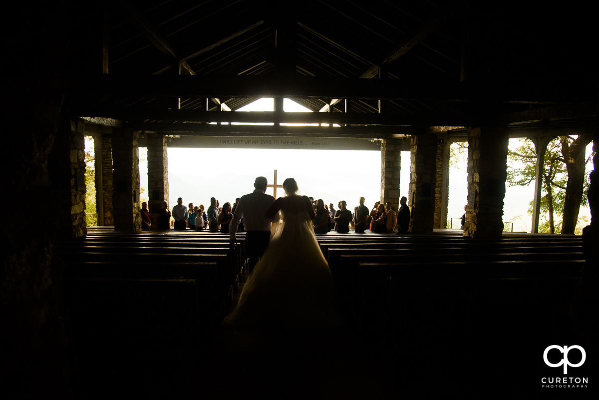 Bride walking down the aisle at Pretty Place before the wedding.