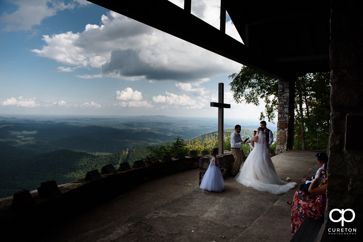 Bride and groom during the wedding ceremony at Symmes Chapel.