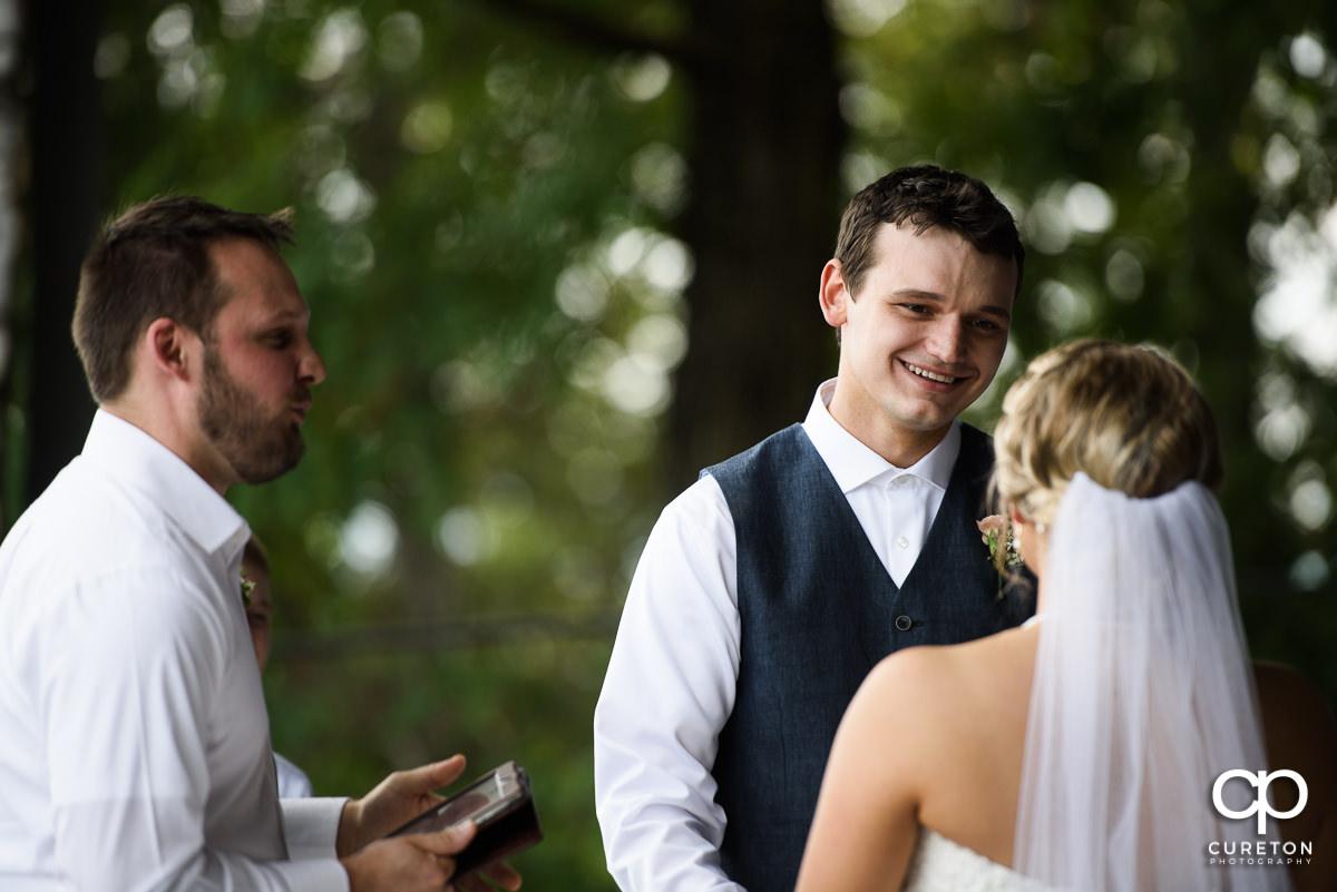 Groom looking at his bride.