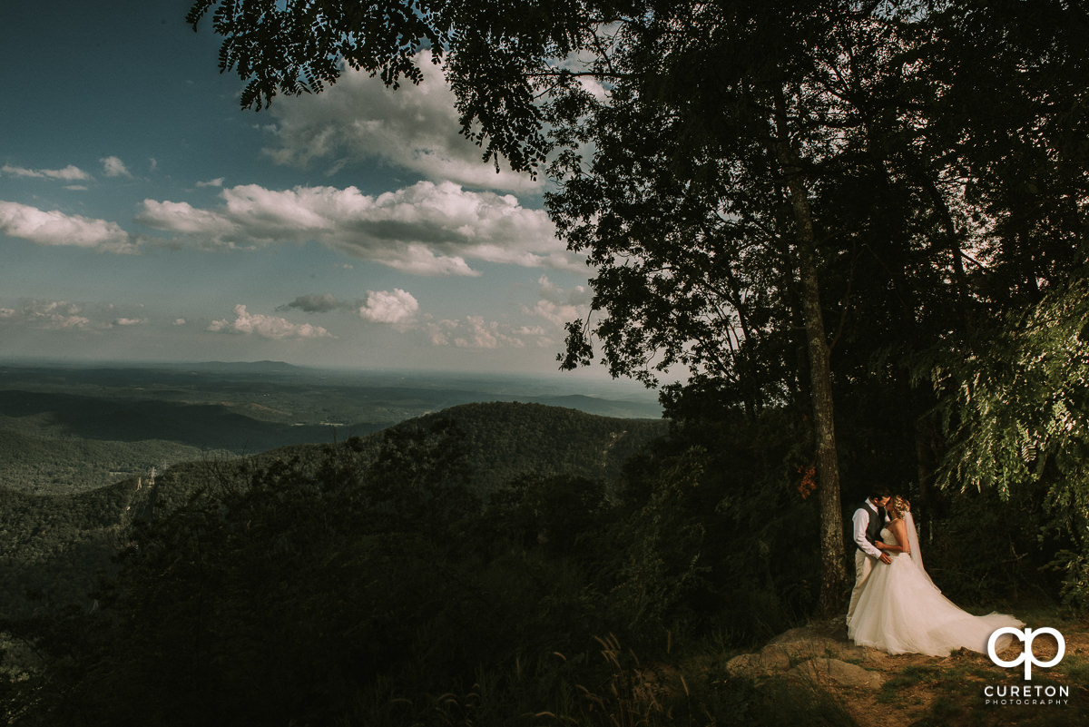 Bride and groom on an epic South Carolina mountaintop after their wedding at Pretty Place, aka Symmes Chapel.