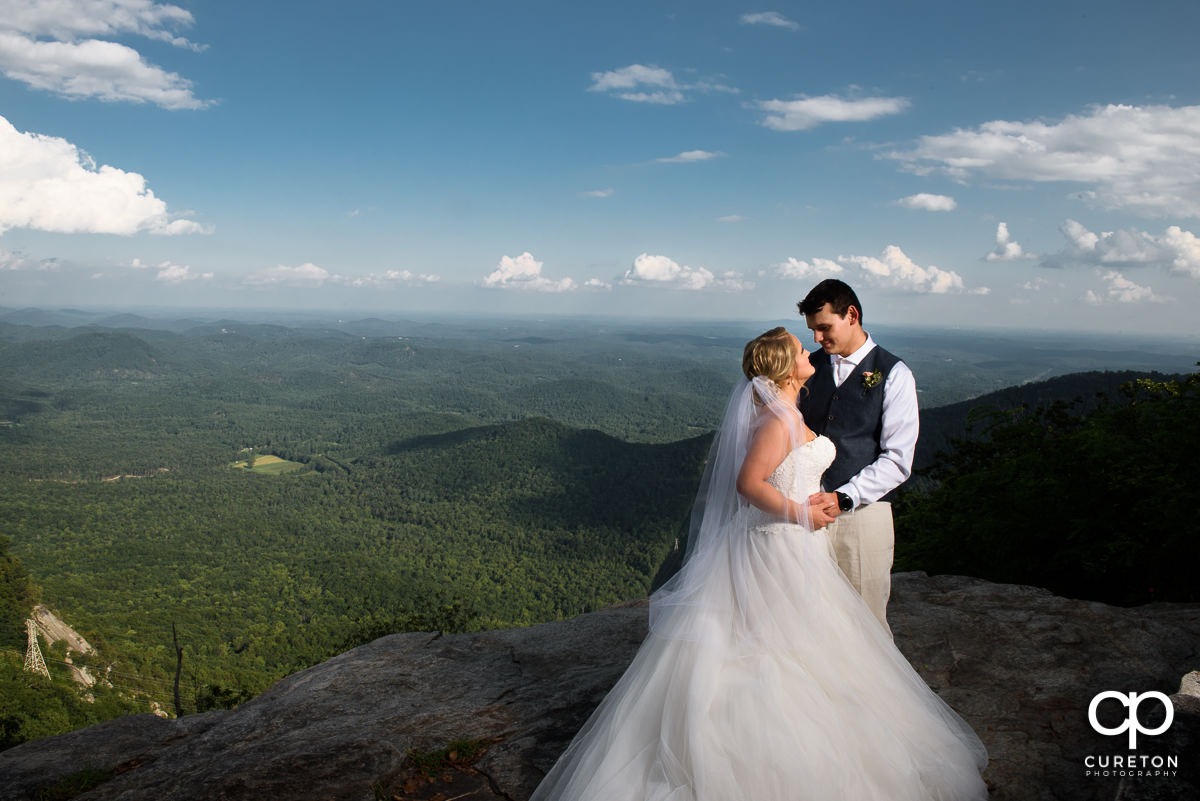 Bride and groom on the rock at Symmes Chapel after their wedding ceremony.