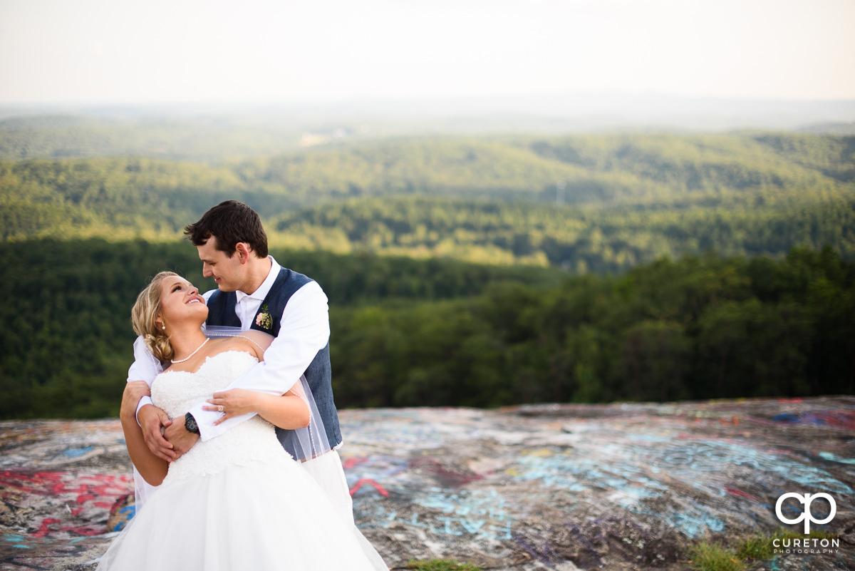Bride and groom dancing on Bald Rock.