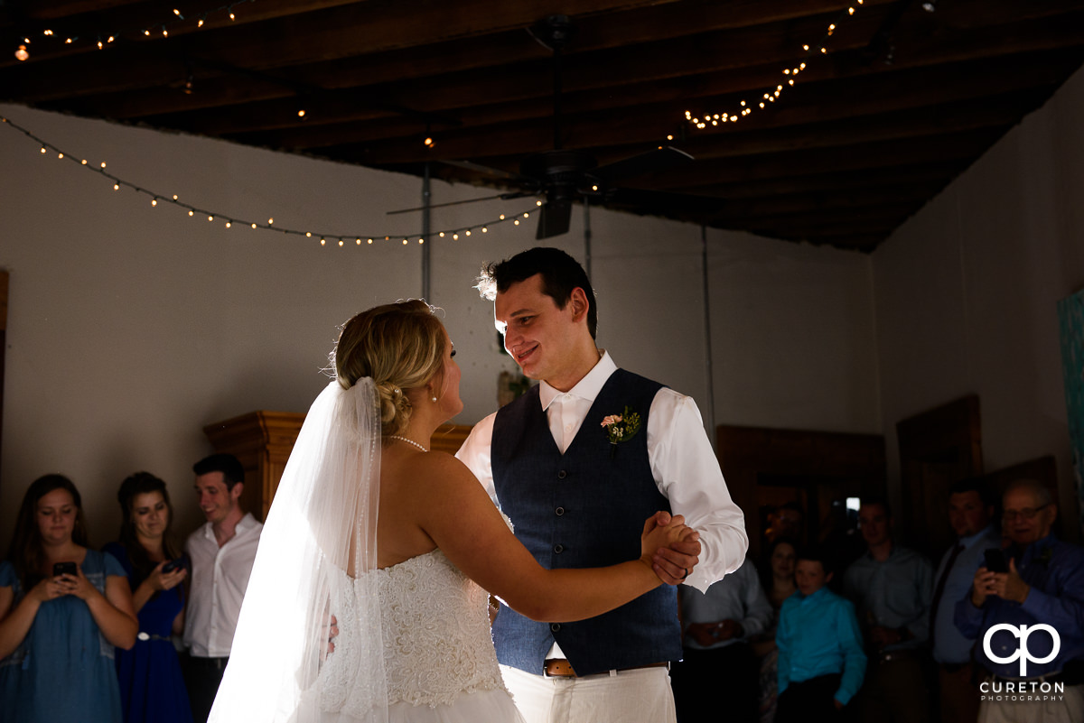Bride and groom having a first dance at Artisan Traders during their wedding reception.