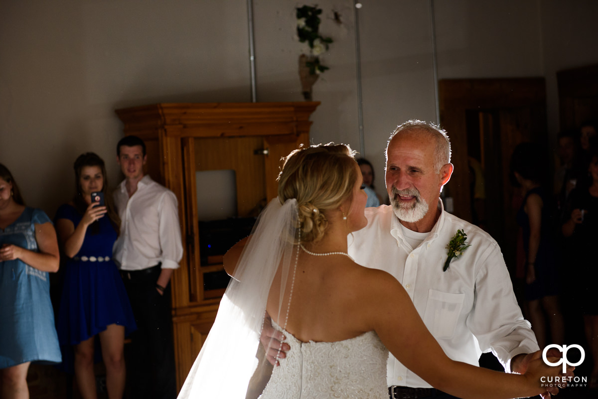 Bride and father dance at Artisan Traders.