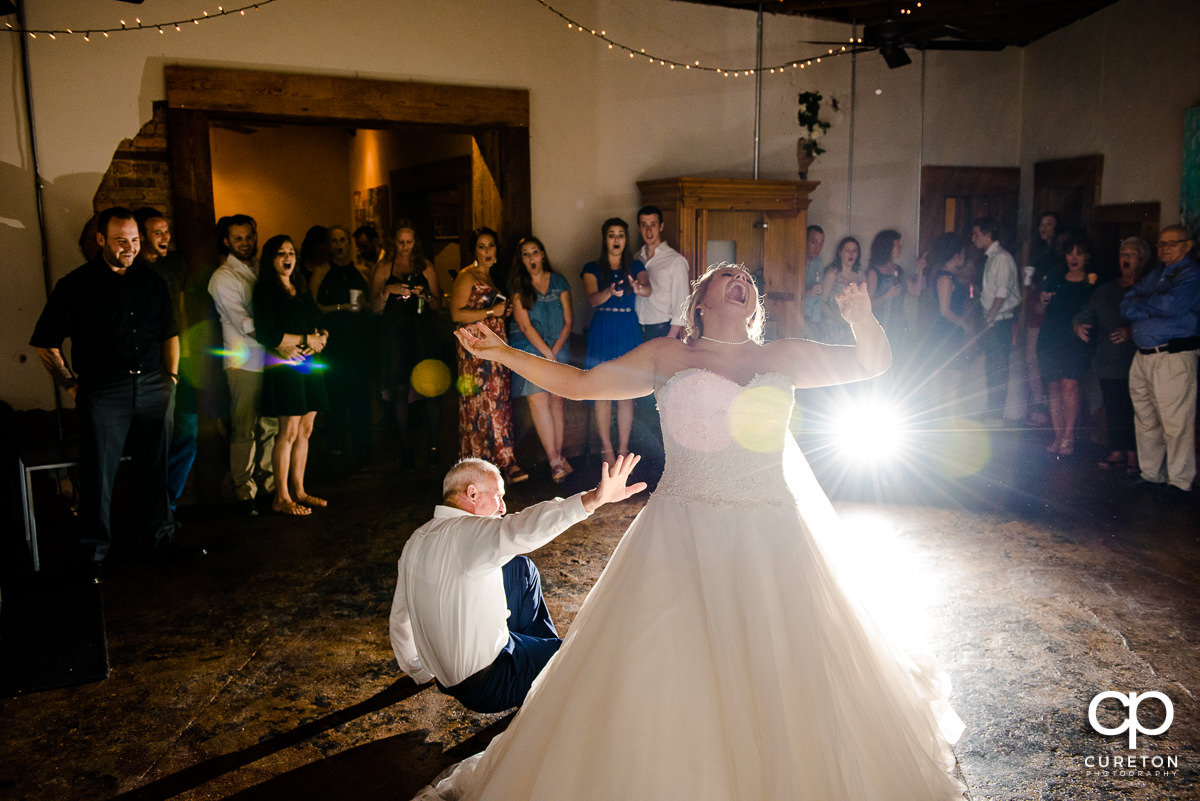 Bride's father tripping and falling during the bride and father dance.