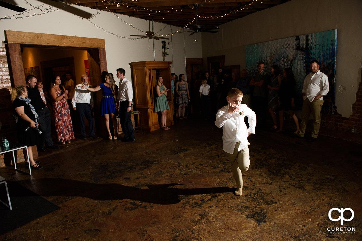 Ring bearer dancing.