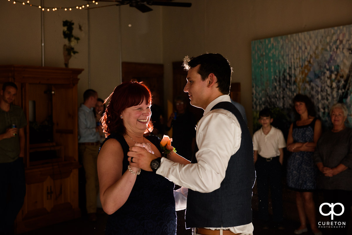 Groom and mother dance at the reception.