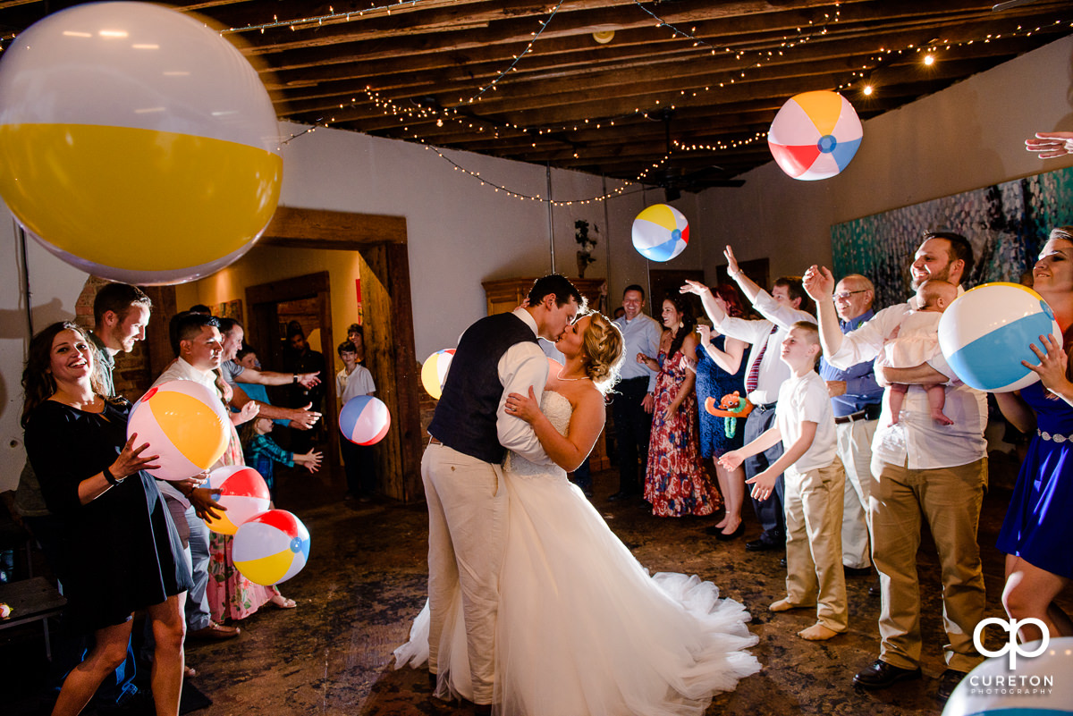 Wedding reception grand exit with beach balls in Greenville,SC at Artisan Traders.
