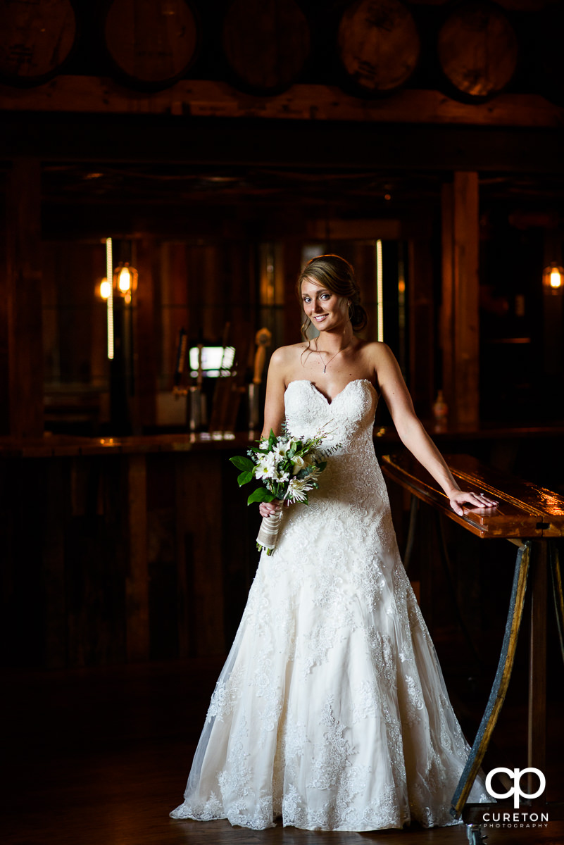 Bride in the whiskey bar during her bridal session at Revel Event Center in Greenville,SC.