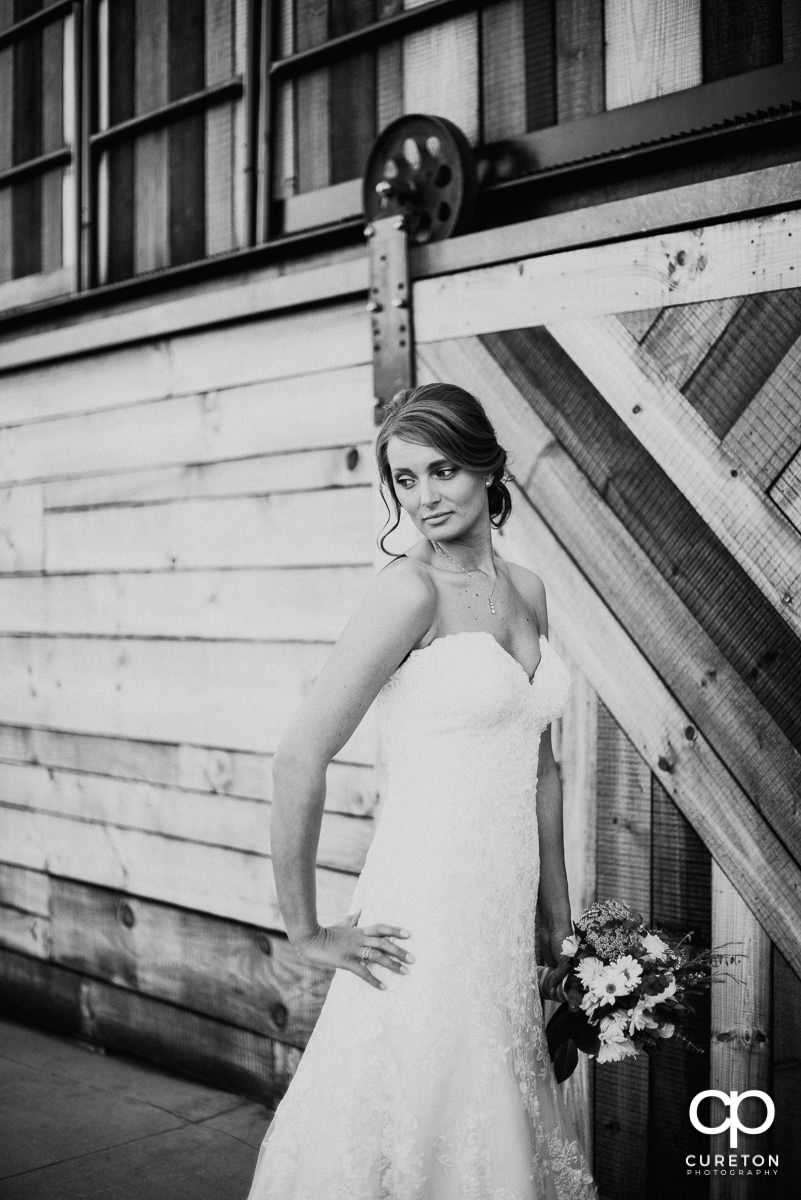 Bride outside Revel near a cool woodworked wall.