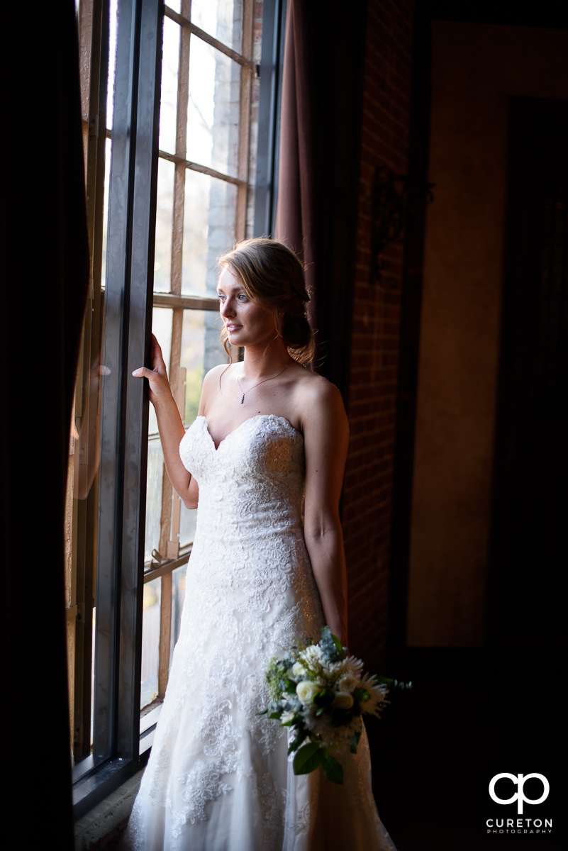 Bride in the window at Revel Event Center.