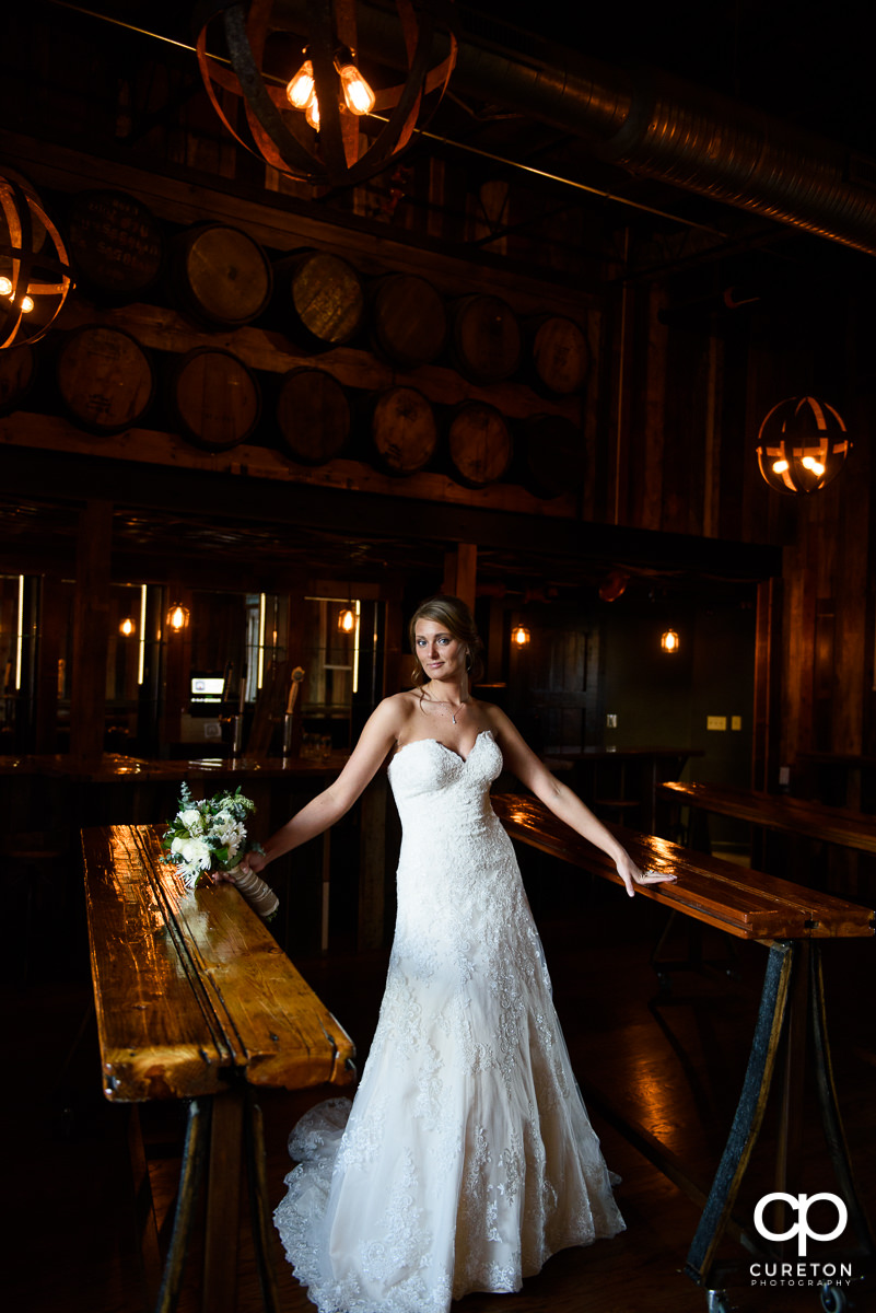 Bride standing in the bar at Revel.
