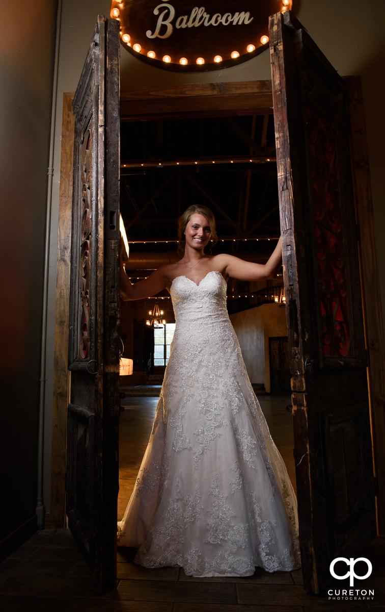 Bride opening doors at Revel.