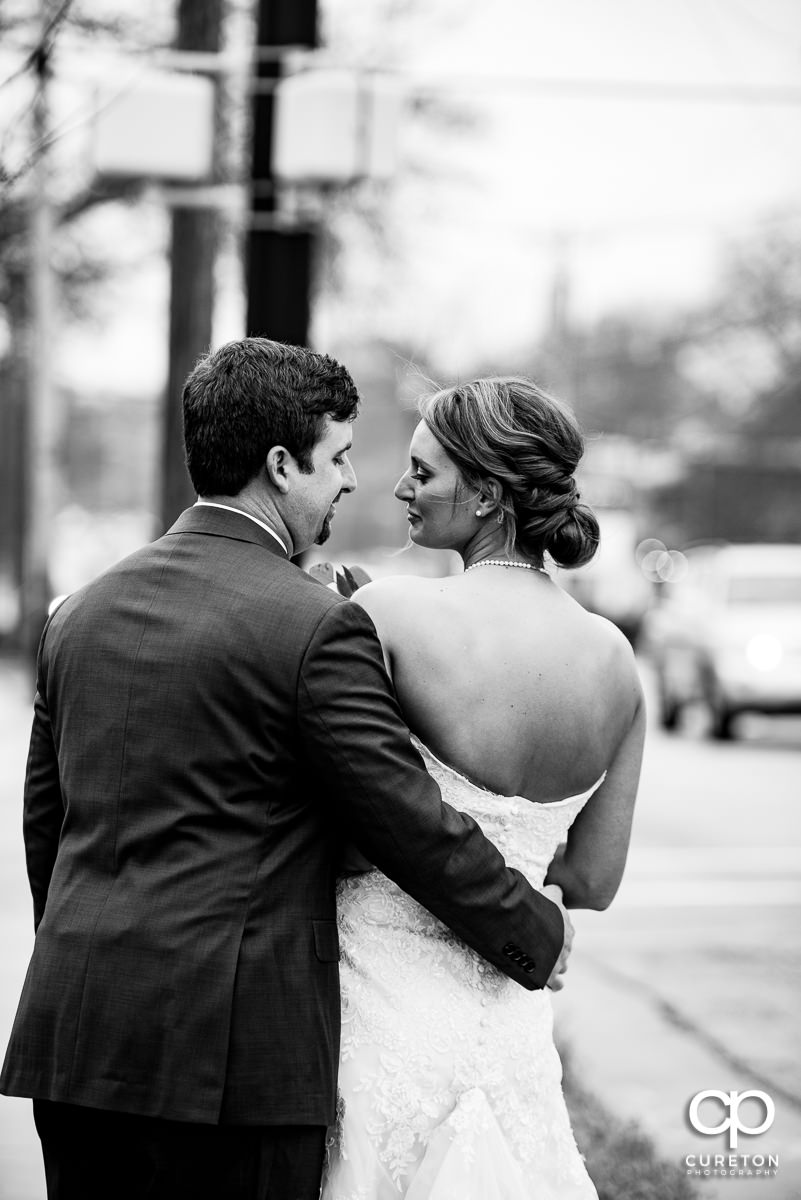 Bride and groom walking down Stone Avenue in Greenville,SC.
