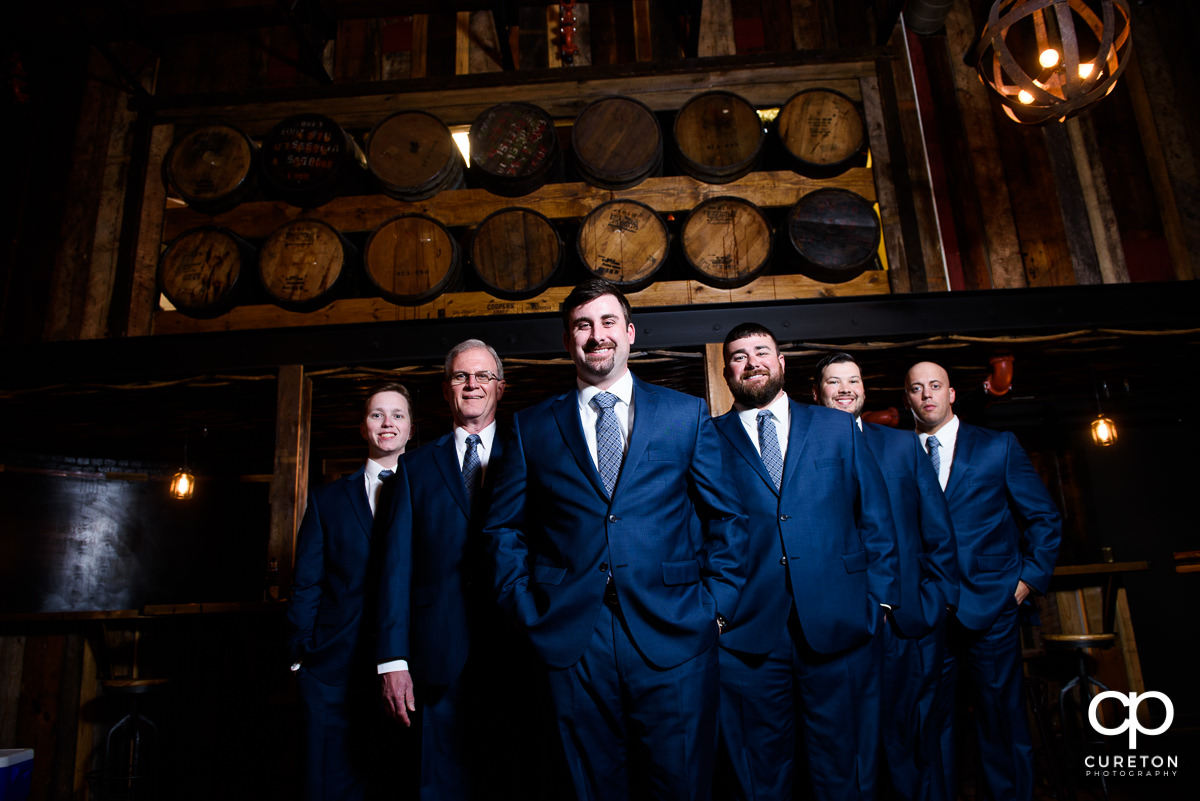 Groomsmen in the whiskey bar at Revel Event Center.