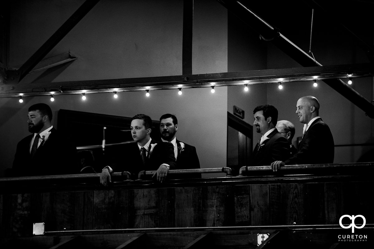 Groomsmen in the balcony at Revel.