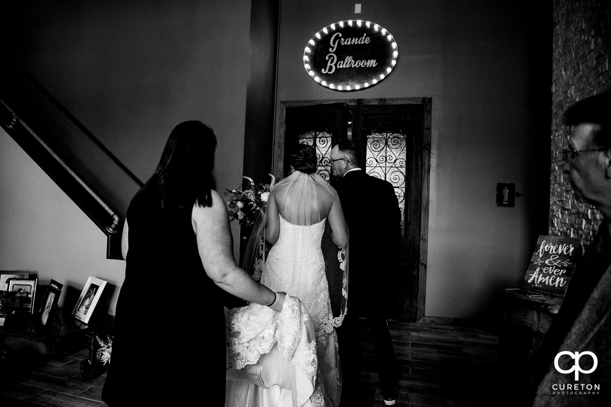 Bride getting ready to walk down the aisle.